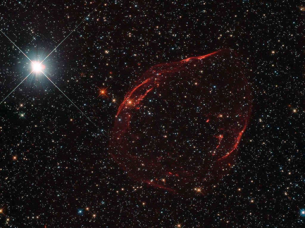 Several thousand years ago, a star some 160,000 light-years away from us exploded as a Type Ia supernova. The aftermath of this energetic detonation is shown in this image from the NASA/ESA Hubble Space Telescope. The remnant has been designated DEM L71. Credit: gsfc/Flickr, CC BY 2.0