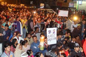 People taking out a candle march demanding justice for Ankit Saxena. Credit: PTI