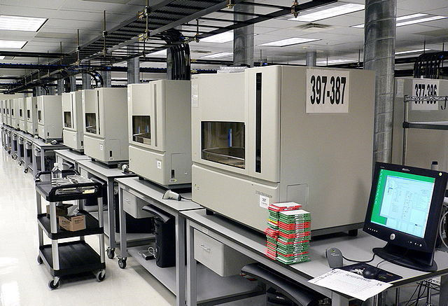 A row of DNA sequencing machines. Caption and photo: jurvetson/Flickr, CC BY 2.0