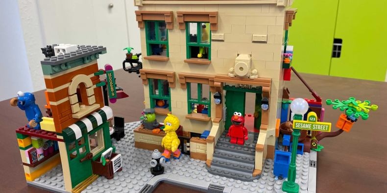 The sesame street lego set, featuring the iconic buildings from the show and the main characters scattered throughout.