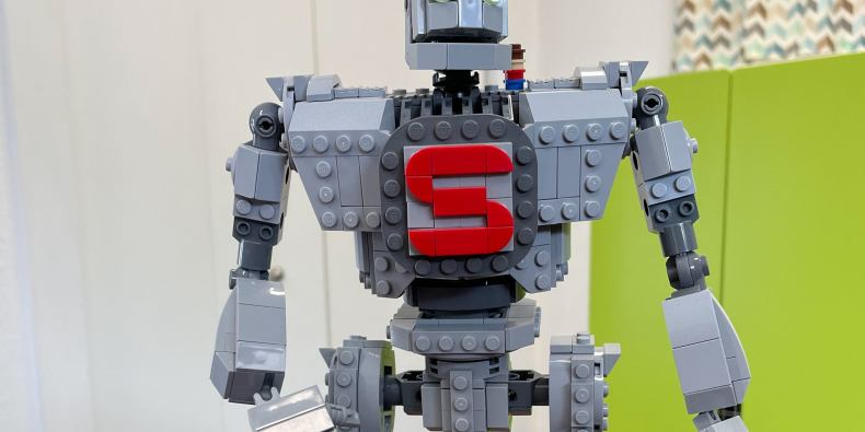 A lego version of the iron giant, complete with a lego Hogarth on the giant's shoulders.