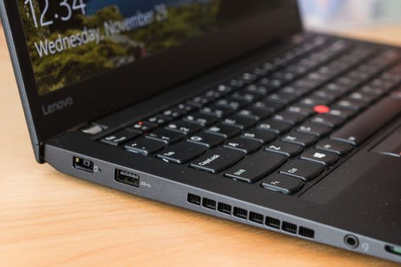 The ports mentioned in the caption, which are on the left side of the laptop (from its screen to its forward edge).