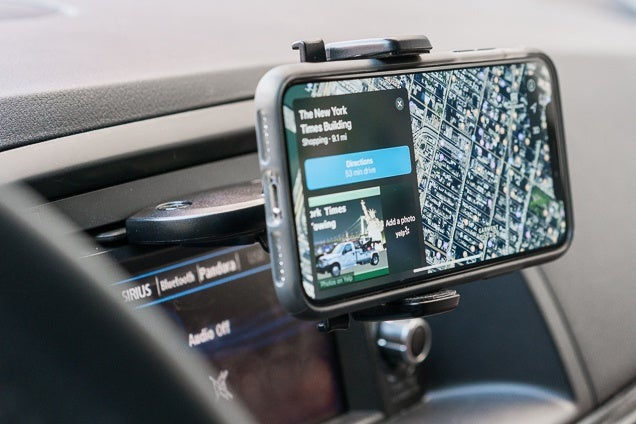 Our Pick For Best Car Phone Mount Vents The Is Holding A Smartphone