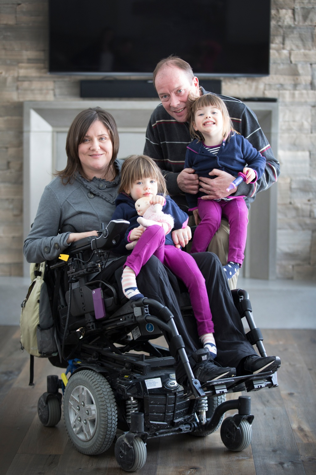quadriplegic wheelchair wooden baby doll high chair mom raising twin girls faces extra challenges