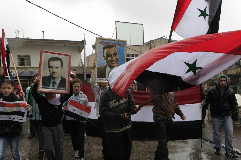 Illustrative: Druze march in support of Syrian President Bashar Assad in the town of Majdal Shams on the Golan Heights. (Tsafrir Abayov/Flash90/File)