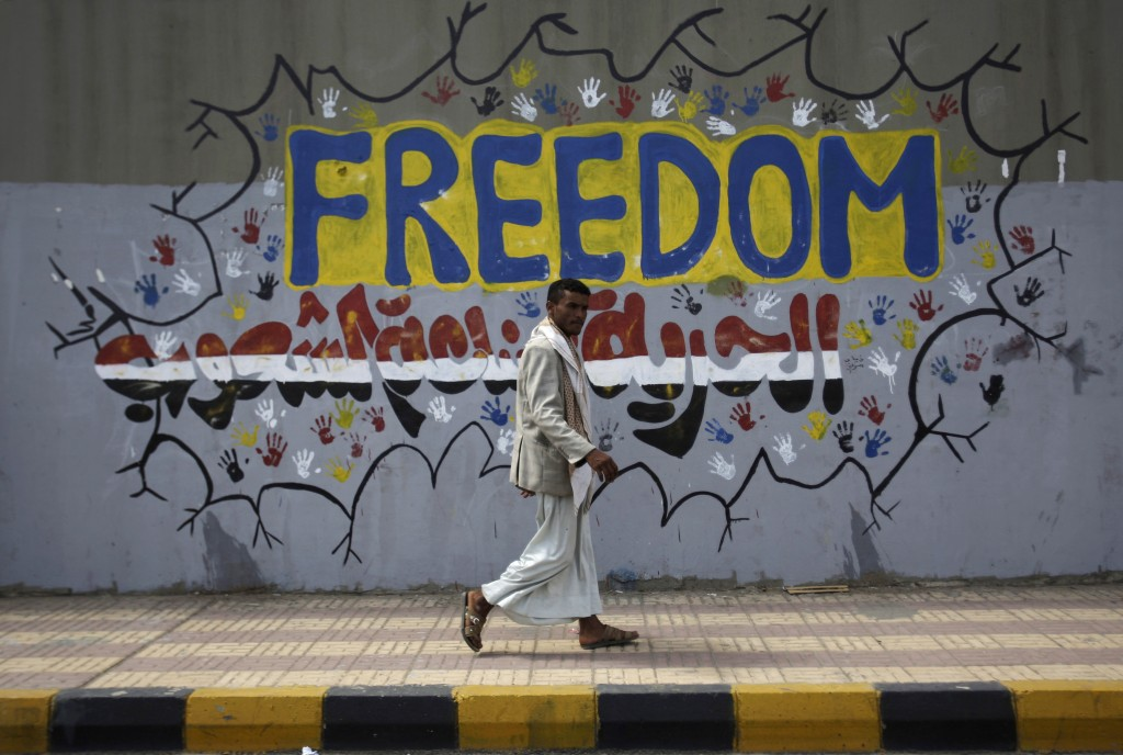 'Freedom is made by people,' reads the graffiti on a street where protesters demanded a trial for former resident Ali Abdullah Saleh in Sanaa, Yemen (photo credit: AP/Hani Mohammed)