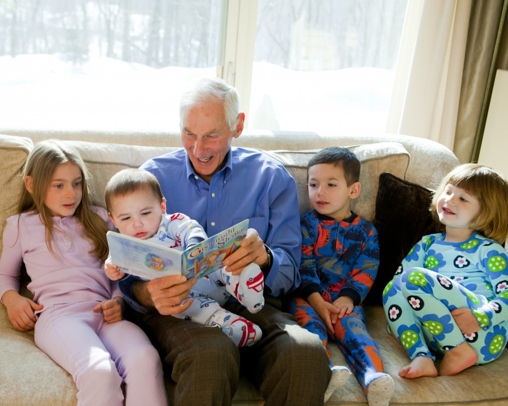 Harold Grinspoon, the founder of PJ Library, reads one of the program's books with a gaggle of children. (photo credit: PJ Library/JTA)