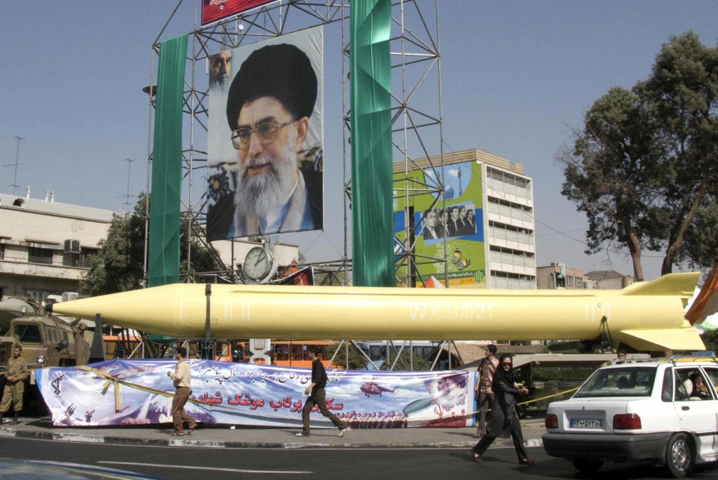 A military exhibition displays the Shahab-3 missile under a picture of the Iranian supreme leader Ayatollah Ali Khamenei, in Tehran, in 2008 (photo credit: AP/Hasan Sarbakhshian)