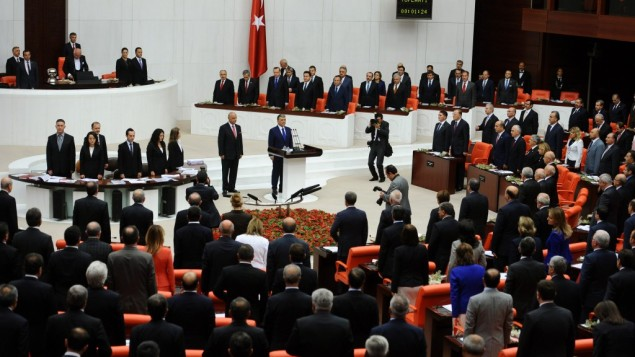 Turkish lawmakers and ministers listen to President Abdullah Gul, center, at Turkey's parliament in Ankara on Monday. (photo credit: AP)
