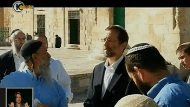 Moshe Feiglin (in black jacket, second from right) prays on the Temple Mount, Monday (photo credit: screen capture/Channel 10)
