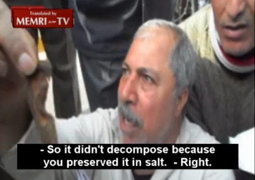 Egyptian protester Ibrahim Muhammad Ibrahim holds up what he claims is an ear he chopped of a dead Israeli officer during the 1973 war at a protest in Cairo (photo credit: image capture/MEMRI)
