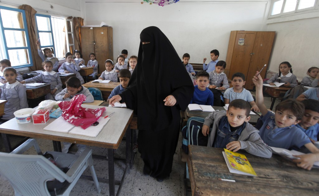 Illustrative: Palestinian children attend a class at the UNRWA elementary school in the Shati refugee camp in Gaza City, April 2013. (AP/Hatem Moussa)