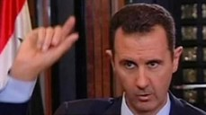 Syrian President Bashar Assad seen during a television interview in Damascus, earlier this month (photo credit: AP/CBS)