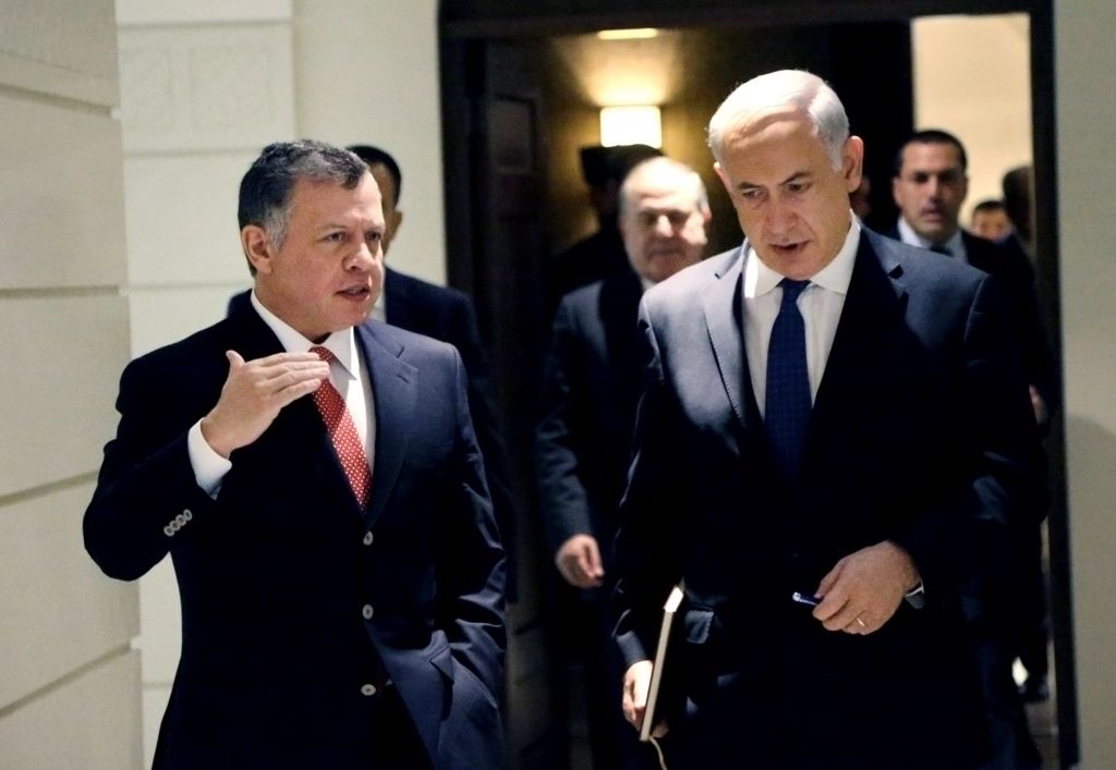 Prime Minister Benjamin Netanyahu, right, and Jordan's King Abdullah II, during the former's surprise visit to Amman on January 16, 2014 (photo credit: AP/Yousef Allan/Jordanian Royal Palace)