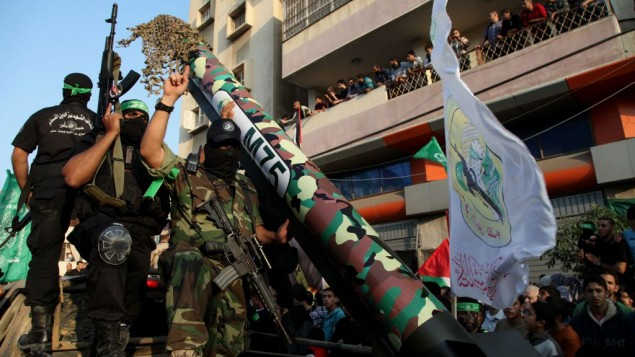 Hamas terrorists show off an M-75 home made rocket in a military parade marking the first anniversary of the eight-day Operation Pillar of Defense, in Gaza City, 14 November 2013. (Photo credit: Emad Nassar/Flash90)
