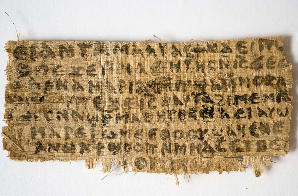 September 5, 2012, file photo shows a fragment of papyrus that divinity professor Karen L. King said is the only existing ancient text that quotes Jesus explicitly referring to having a wife. (photo credit: AP/Harvard University, Karen L. King, File)