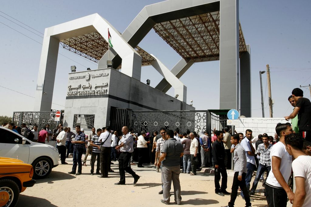 Palestinians wait to cross into Egypt at the Rafah border crossing between Egypt and the southern Gaza Strip on June 17, 2014 (photo credit: Abed Rahim Khatib/Flash90)