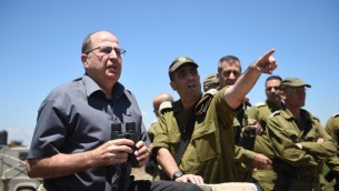 Defense Minister Moshe Ya'alon on the Golan Heights, northern Israel, June 30, 2015, looking toward Syria. (Eden Moladavski/Ministry of Defense)