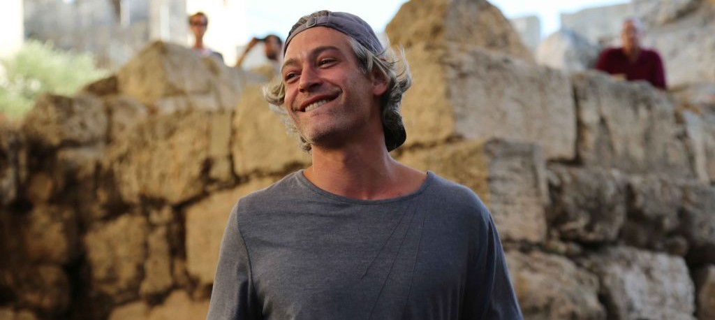 American Jewish singer Matisyahu smiles as he performs at the Sacred Music Festival in the Old City of Jerusalem, September 4, 2015. (Eric Cortellessa/The TImes of Israel)
