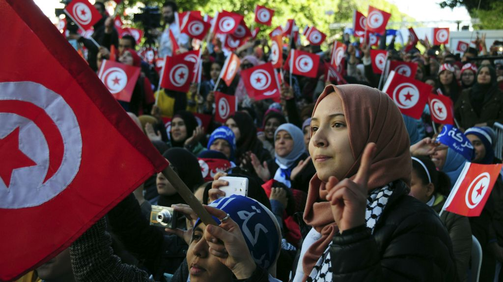 Celebrating the fifth anniversary of the Arab Spring in Tunis, Tunisia, on January 14, 2016. (AP/Riadh Dridi)