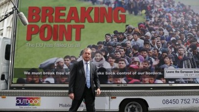 UK Independence Party Leader (UKIP) Nigel Farage in front of a 'Breaking Point' billboard that has been called racist on June 16, 2016. (AFP PHOTO / Daniel Leal-Olivas)