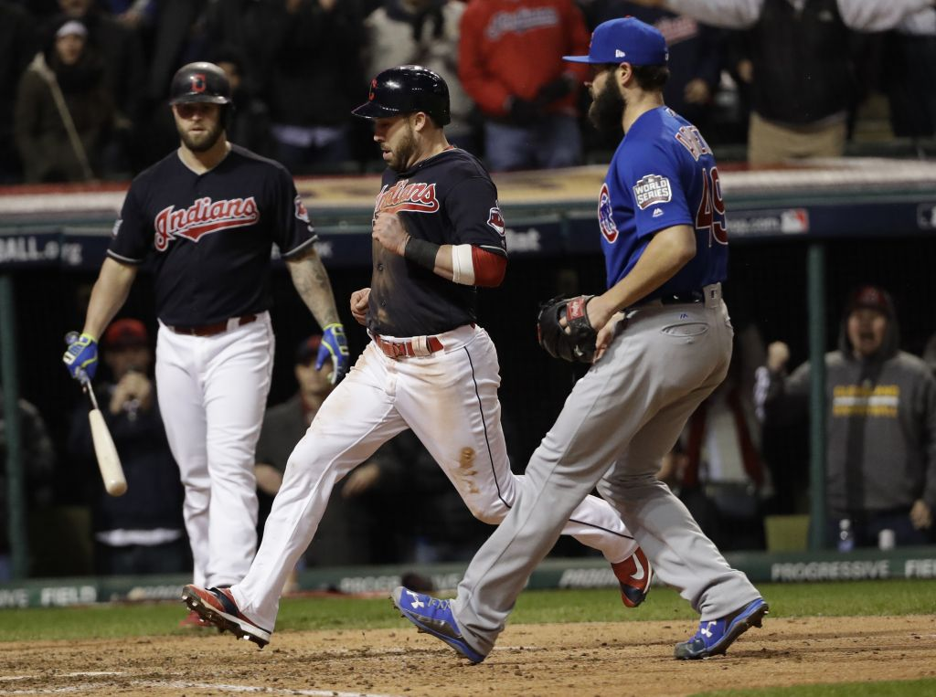 Cleveland Indians' Jason Kipnis scores past Chicago Cubs starting pitcher Jake Arrieta on a wild pitch during the sixth inning of Game 2 of the Major League Baseball World Series Wednesday, October 26, 2016, in Cleveland. (AP Photo/David J. Phillip)