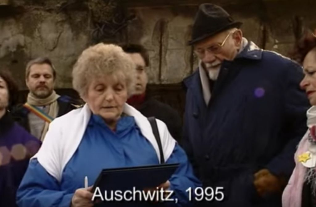 Mengele twin Eva Mozes Kor at Auschwitz on January 27, 1995, reading her letter of forgiveness to Nazi Dr. Hans Munch. (Youtube screenshot)