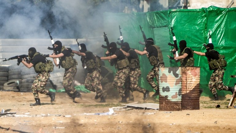 Members of the Palestinian terror group Hamas's security forces stage a mock raid on IDF post during a graduation ceremony in Gaza City on January 22, 2017. (Mahmud Hams/AFP)
