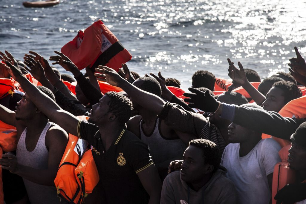 Illustrative: Migrants reach out for flotation vests as they wait to board the MV Aquarius, as 193 people and two corpses are recovered Friday, Jan. 13, 2017 from international waters in the Mediterranean Sea about 22 miles (35 km) north of Sabrata, Libya. (AP Photo/Sima Diab)