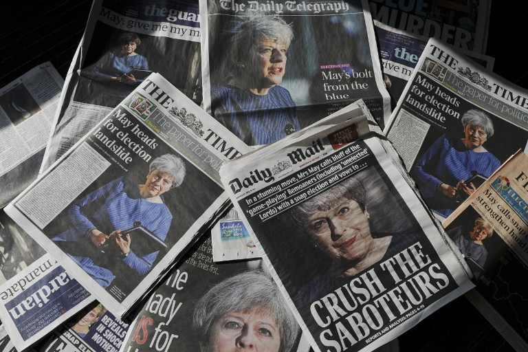 An arrangement of newspapers pictured in London on April 19, 2017, as an illustration, shows the front pages of the UK daily newspapers reporting on British Prime Minister Theresa May's announcement of an early general election. (AFP PHOTO / DANIEL SORABJI)