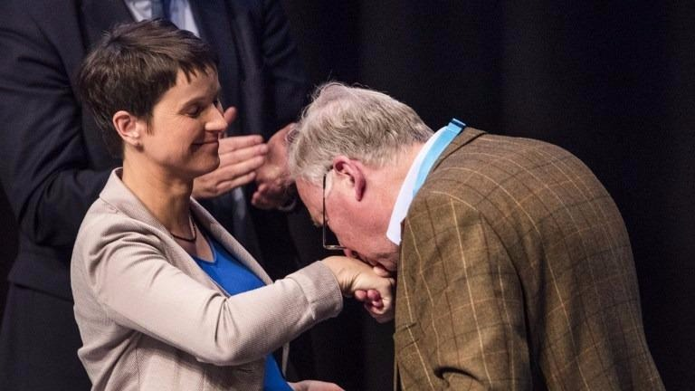 Alexander Gauland (R) kisses the hand of the head of Germany's right-wing populist Alternative for Germany (AfD) party Frauke Petry after his nomination together with Alice Weidel (Unseen) as campaign co-leader of AfD's party for the next German general election, during the party congress at the Maritim Hotel in Cologne, western Germany, on April 23, 2017. (Odd ANDERSEN / AFP)