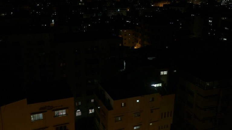 A general view shows Gaza City in the evening hours during a power cut, on April 27 2017. (AFP Photo/Mohammed Abed)