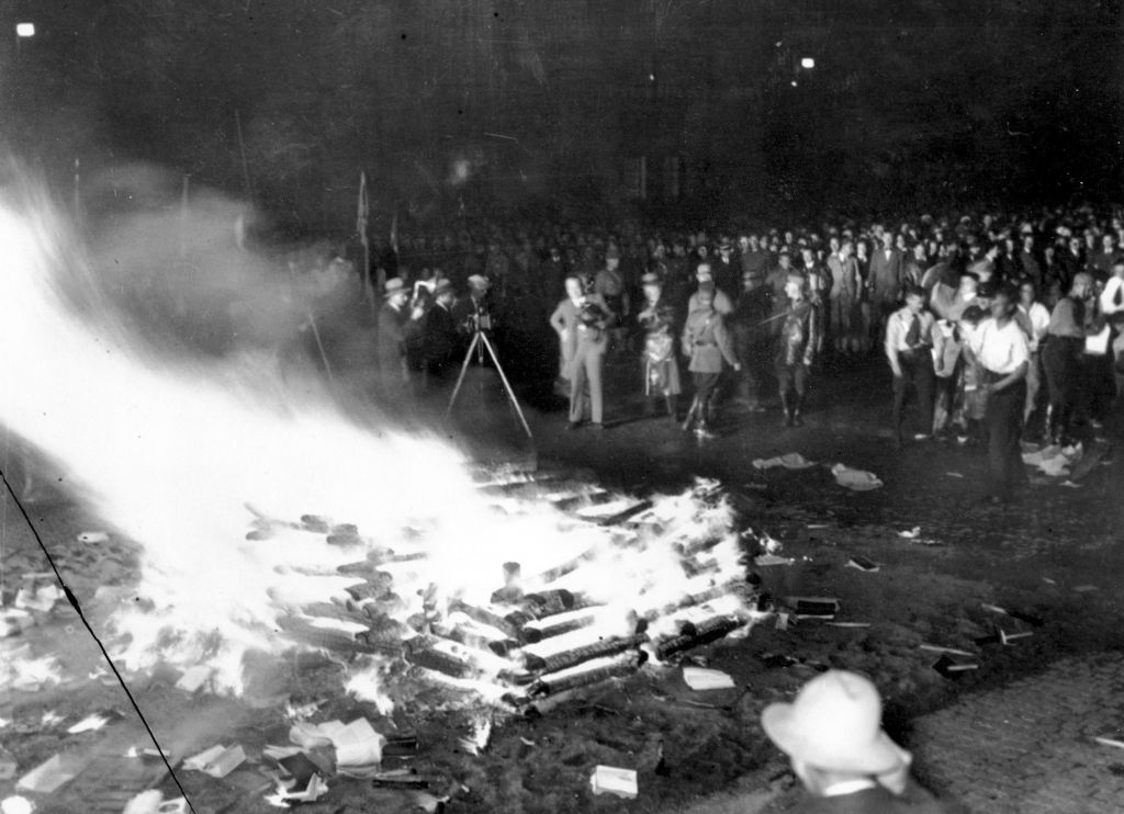 "A crowd gathers to witness thousands of books, considered to be ""un-German,"" burn in Opera Square in Berlin, Germany, during the Buecherverbrennung book burnings on May 10, 1933. (AP Photo)"
