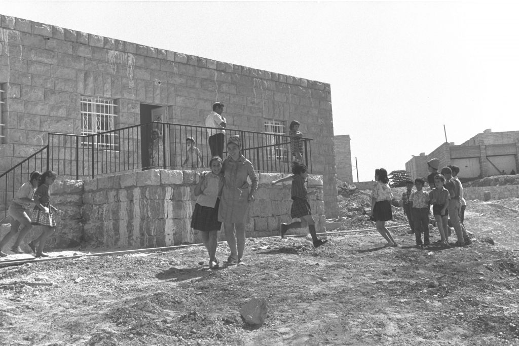 A 1971 photo of school children playing in front of the public religious school in Kiryat Arba. (Moshe Milner)