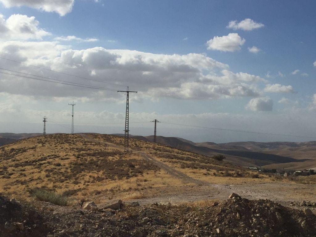 View of a hill slotted from development in the Judean Desert in the West Bank settlement of Kfar Adumim. (Amanda Borschel-Dan/TOI)