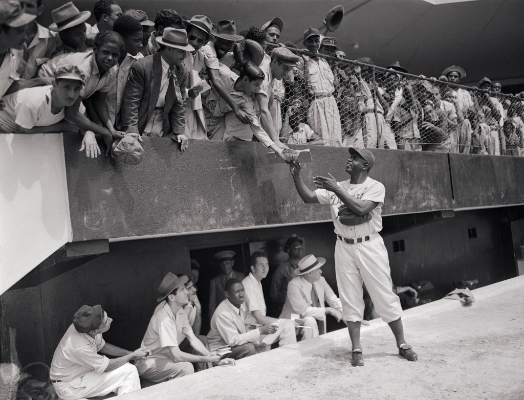 Jackie Robinson signing autographs during spring training with the Brooklyn Dodgers, 1948. (National Museum of American Jewish History)