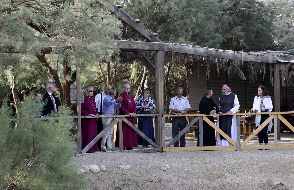 The Archbishop of Canterbury, Justin Welby, center left, visits the archaeological site al-Maghtas in Jordan Wednesday. May, 3, 2017. (AP Photo/Sam McNeil)