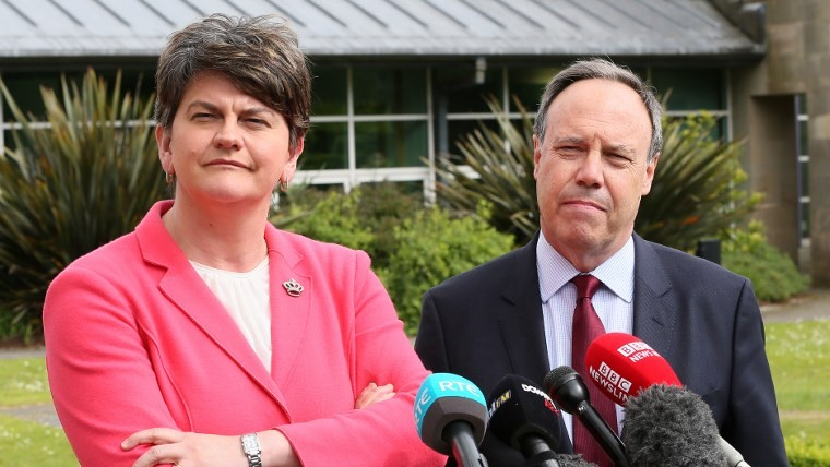 Democratic Unionist Party (DUP) leader Arlene Foster (L), and DUP Deputy Leader Nigel Dodds prepare to address the media outside Stormont Castle, on the Stormont Estate in Belfast, Northern Ireland, on June 12, 2017. (AFP PHOTO / Paul FAITH)
