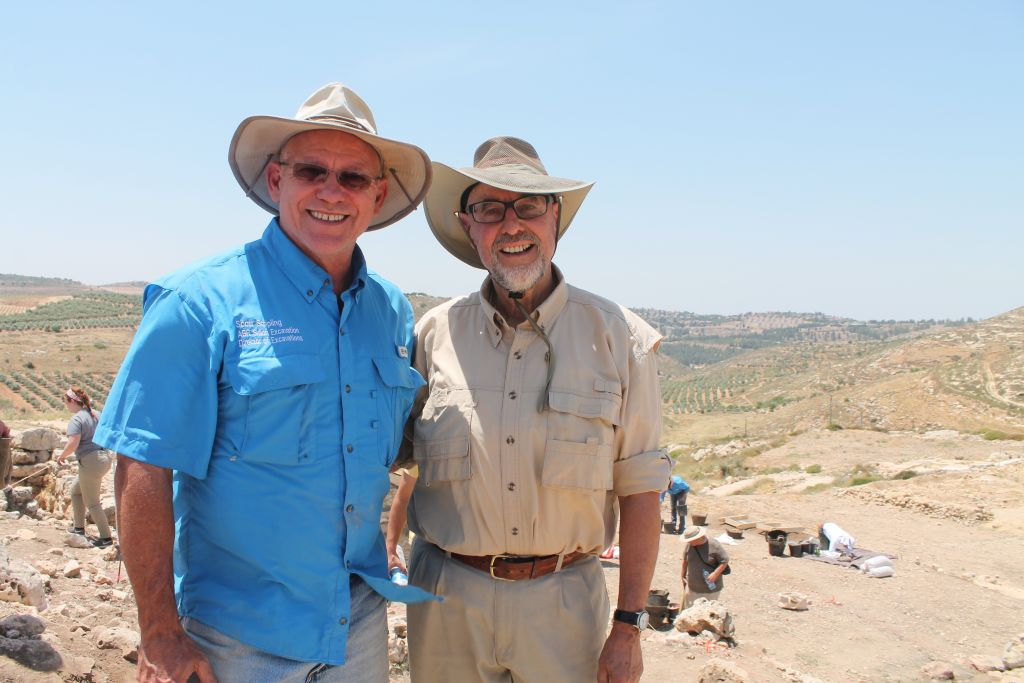 Head of the Shiloh excavation Dr. Scott Stripling (right), stands with Walt Pasedag, a volunteer with ABR for the past 30 summers. (Amanda Borschel-Dan/Times of Israel)