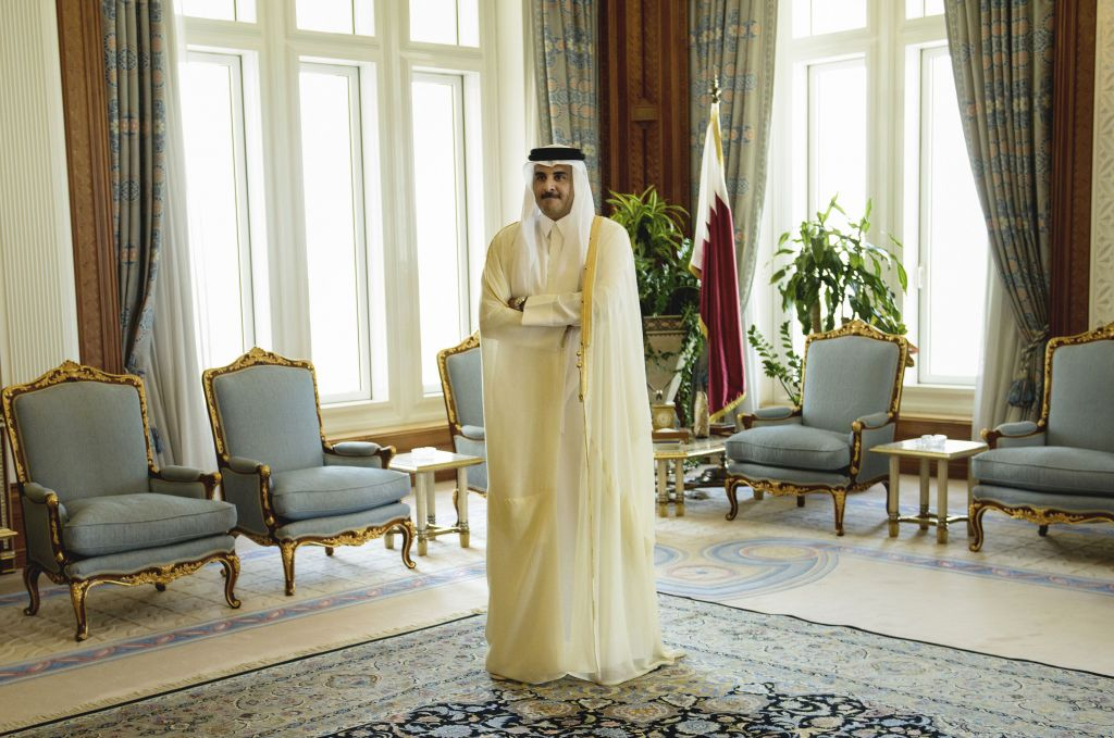 Qatar Emir Sheik Tamim bin Hamad Al-Thani waits for the arrival of U.S. Secretary of State John Kerry ahead of their meeting, at Diwan Palace in Doha, Qatar on August 3, 2015. (Brendan Smialowski/Pool via AP)