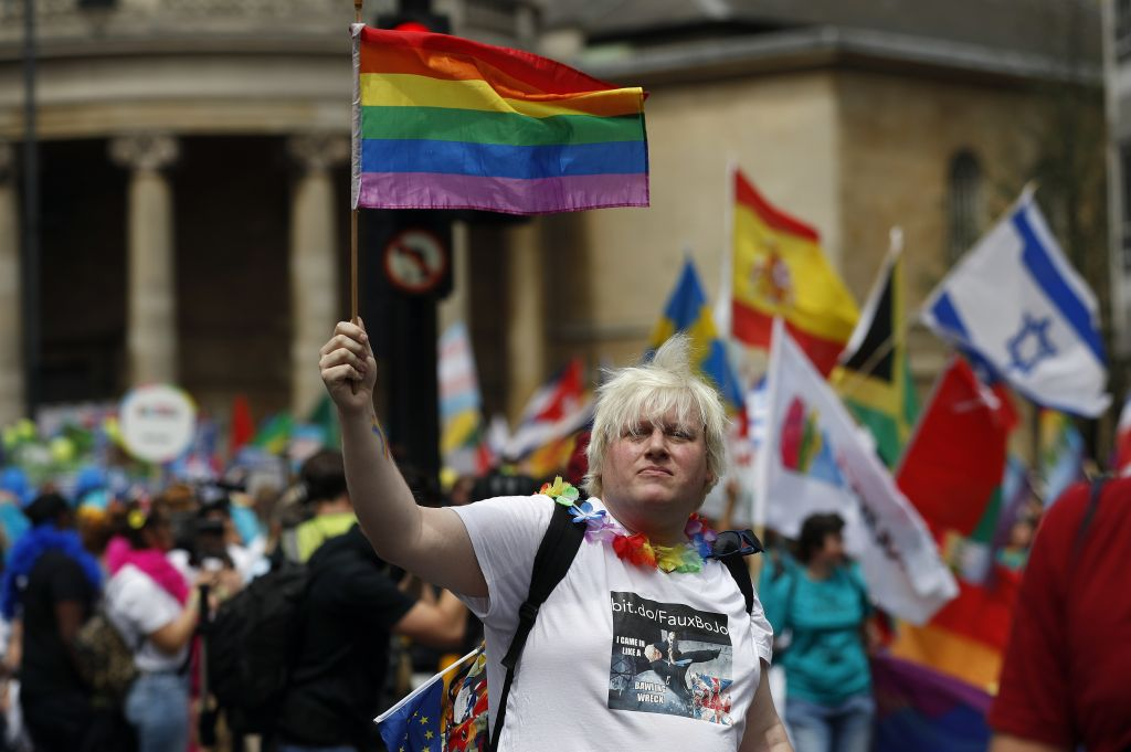 Revelers enjoy the Pride London Parade in London, Saturday, July 8, 2017. (AP Photo/Frank Augstein)