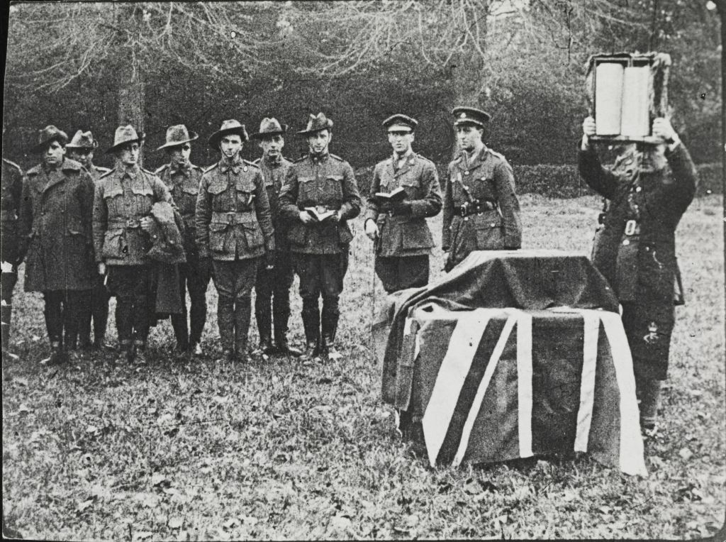Chaplain Reverend David Freedman raises a Torah given to him by a congregation in Alexandria, Egypt, at a service in the field circa 1917. This scroll has become known as the 'Anzac Torah.' (Courtesy)