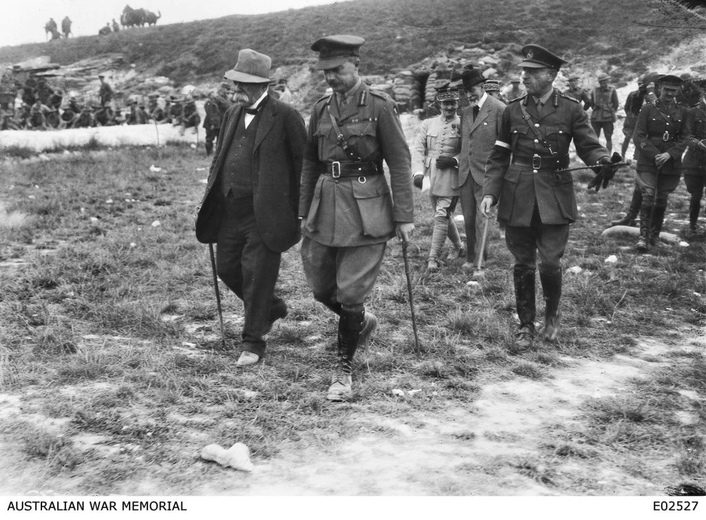 French prime minister M. Georges Benjamin Clemenceau on his only visit to the Australian front, walking with Major General E. G. Sinclair-MacLagan and Lieutenant General Sir John Monash (right, foreground). At far right is Lieutenant Colonel J. D. Lavarack. (Courtesy of the Australian War Memorial)