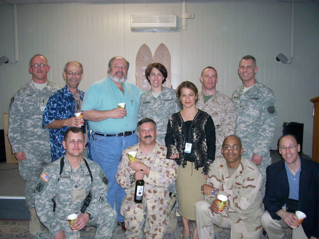 Major Scott Leonard and other Jewish ANZAC soldiers enjoying some Five Stones kosher wine from Australia at a Friday night service in early 2008. MAJ Stuart Wolfer, back right, was killed in action on April 6 of that year. (Courtesy Scott Leonard)