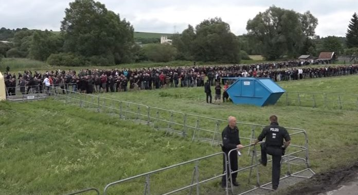 Attendees wait in line to enter the neo-Nazi 'Rock against Foreign Domination' festival in Thuringia, Germany on July 15, 2017. (Screen capture/YouTube)