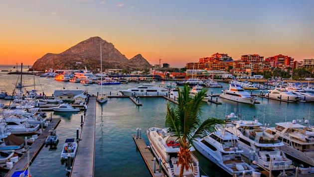 Cabo San Lucas Marina at sunset (Photo via LindaYG / iStock / Getty Images Plus)