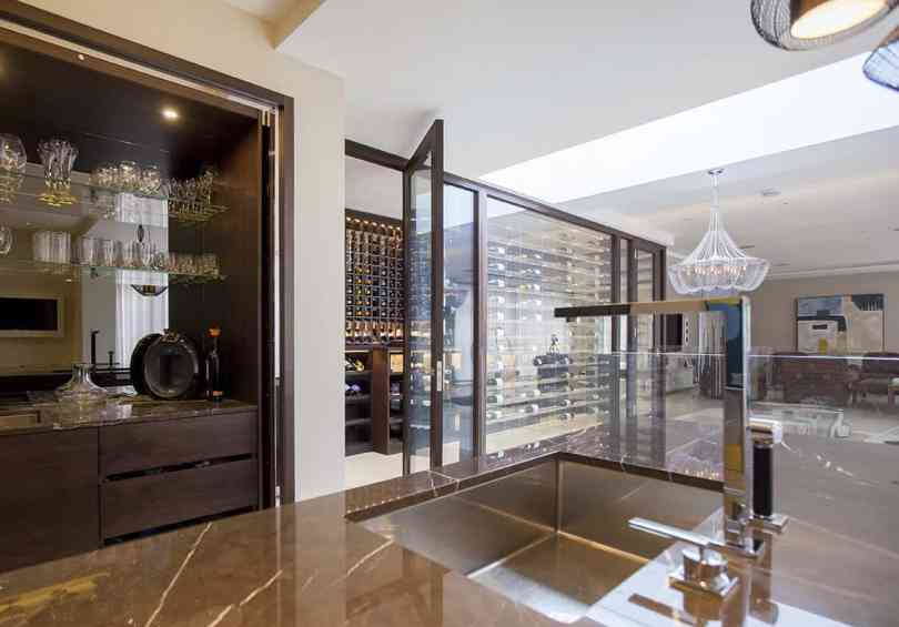 clear casing wine cellar Chic Ways To Design Your Wine Room