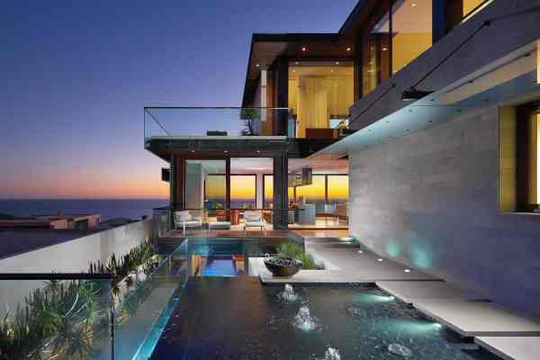 Overlapping Pools & Ocean View Define Coastal Home