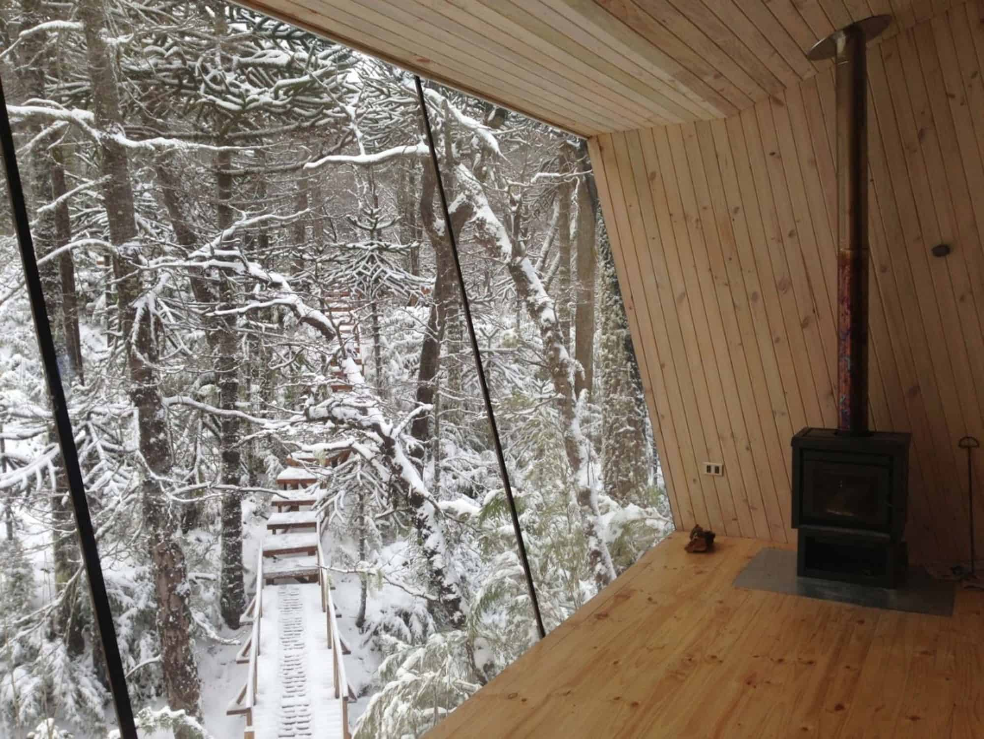 Winter Cabin Accessed by Elevated Walkway