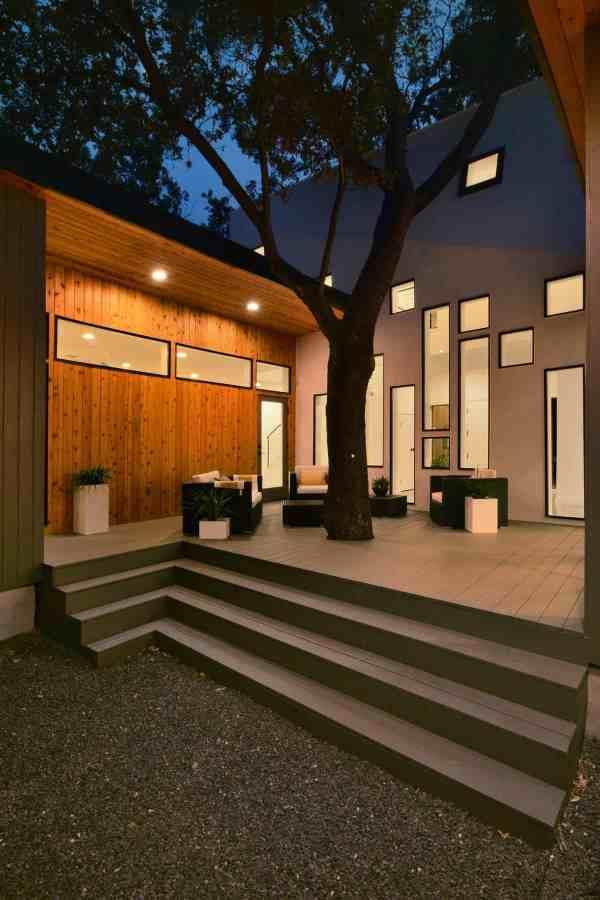 Bold And Modern U-shaped Courtyard House Designed Trees